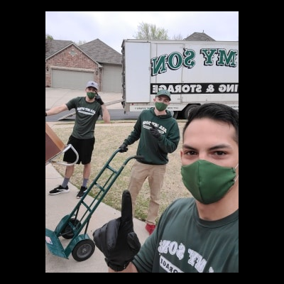 three guys with green medical masks over mouths
