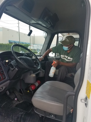 man cleaning and disinfecting truck